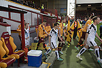 Motherwell 3 Dundee 1, 12/12/2015. Fir Park, Scottish Premiership. The teams walking out on to the pitch before Motherwell (in amber) play Dundee in a Scottish Premiership fixture at Fir Park. Formed in 1886, the  home side has played at Fir Park since 1895. Motherwell won the match by three goals to one, watched by a crowd of 3512 spectators. Photo by Colin McPherson.