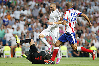 Benzema of Real Madrid and Moya and Miranda of Atletico de Madrid during La Liga match between Real Madrid and Atletico de Madrid at Santiago Bernabeu stadium in Madrid, Spain. September 13, 2014. (ALTERPHOTOS/Caro Marin)