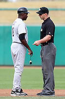 Salt River Rafters manager Stu Cole #18 argues a call with umpire Stephen Barga during an Arizona Fall League game against the Mesa Solar Sox at HoHoKam Park on November 4, 2011 in Mesa, Arizona.  Mesa defeated Salt River 12-10.  (Mike Janes/Four Seam Images)