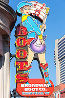 A neon sign advertises the Broadway Boot Company on the outside of the store in Nashville, Tennessee.