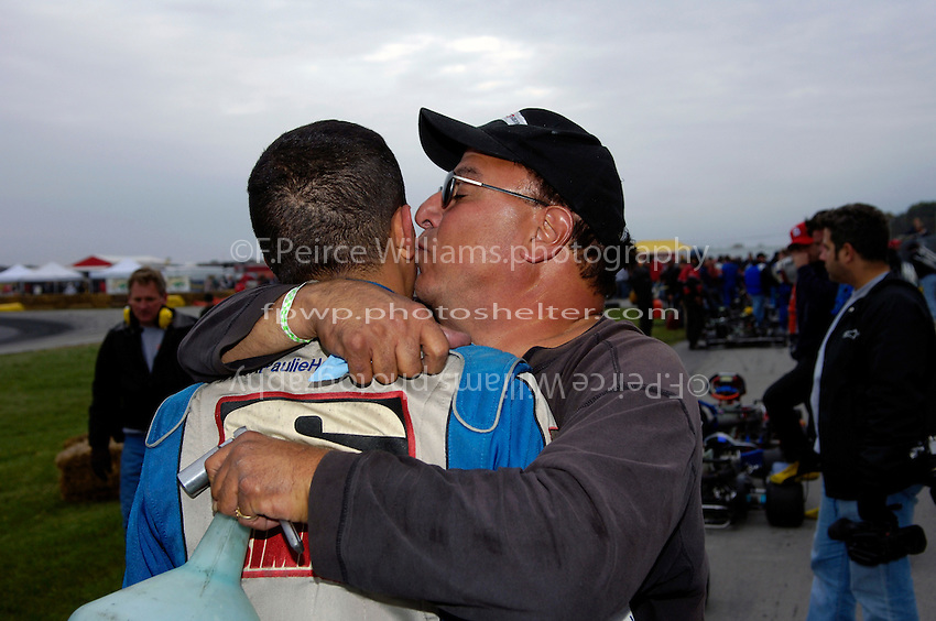 Winner Paulie Harraka gets a kiss from father Paul....Copyright©F.Peirce Williams 2006.ref.Digital Image Only