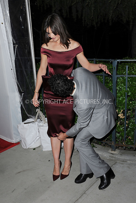 WWW.ACEPIXS.COM<br /> April 21, 2014 New York City<br /> <br /> Zac Posen and Katie Holmes attending the 'Miss Meadows' Premiere during 2014 Tribeca Film Festival at the SVA Theater on April 21, 2014 in New York City. <br /> <br /> By Line: Kristin Callahan/ACE Pictures<br /> ACE Pictures, Inc.<br /> tel: 646 769 0430<br /> Email: info@acepixs.com<br /> www.acepixs.com