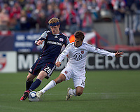 DC United forward Josh Wolff (16) tackles New England Revolution midfielder Pat Phelan (28). In a Major League Soccer (MLS) match, the New England Revolution defeated DC United, 2-1, at Gillette Stadium on March 26, 2011.