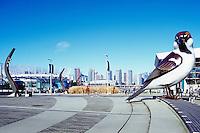 Olympic Plaza at the Village on False Creek (aka Olympic Village), Vancouver, BC, British Columbia, Canada - Giant Sparrow Sculpture (artist - Myfanwy MacLeod) - City of Vancouver Skyline and BC Place Stadium (New Roof completed in 2011) in Background