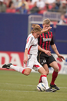 D.C. United's Brian Carroll is marked by the MetroStars' John Wolyniec. D. C. United was defeated by the NY/NJ MetroStars 3 to 2 during the MetroStars home opener at Giant's Stadium, East Rutherford, NJ, on April 17, 2004.