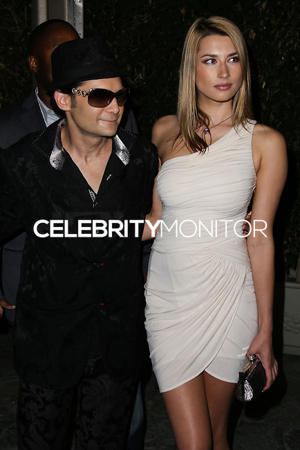 BEVERLY HILLS, CA, USA - MARCH 28: Corey Feldman, Catherine Annette at the Versace Unveiling Of The 1st Pop Recording Artist Superhero - KUBA Ka's Performance Outfits. Designed by the legendary fashion hosuse - Donatella Versace. For the Benefit of the Face Forward Foundation (Plastic Surgery for Destroyed Faces from Violence). Pop entertainer TV personality KUBA Ka, together with VERSACE, unveiled Kuba Ka's new Versace images, for the First Pop Artist/Superhero of the World. He has become the inspiration of Donatella's newest and wildest creations and will celebrate the launch of his new power house conglomerate - KUBA Ka Empire Inc. in collaboration with the sensational fashion house - VERSACE on Friday, his birthday at a red carpet media and celebrity event at the luxurious Peninsula Hotel in Beverly Hills held at the Peninsula Hotel on March 28, 2014 in Beverly Hills, California, United States. (Photo by Xavier Collin/Celebrity Monitor)