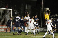 Ethan White #4 of the University of Maryland watches Brendan Birmingham #28 of Penn State pick off a cross during an NCAA 3rd. round match at Ludwig Field, University of Maryland, College Park, Maryland on November 28 2010.Maryland won 1-0.