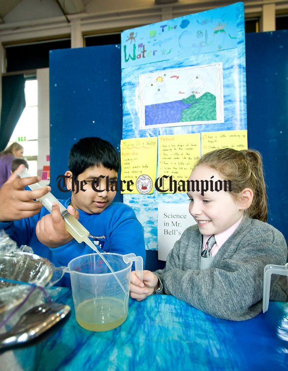 Hriday Mondal and Shannon Hegarty hard at work during Science Week at the Holy Family School in Ennis. Photograph by Declan Monaghan