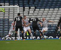 Lassad Nouioui gets a penalty from a Jim Goodwin handball in the St Mirren v Celtic Scottish Communities League Cup Semi Final match played at Hampden Park, Glasgow on 27.1.13.