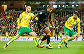 31st October 2017, Carrow Road, Norwich, England; EFL Championship football, Norwich City versus Wolverhampton Wanderers; Wolverhampton Wanderers midfielder Ivan Cavaleirobattles with Norwich City midfielder Tom Trybull and Norwich City defender James Husband