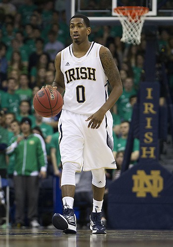 January 19, 2013:  Notre Dame guard Eric Atkins (0) dribbles the ball during NCAA Basketball game action between the Notre Dame Fighting Irish and the Rutgers Scarlett Knights at Purcell Pavilion at the Joyce Center in South Bend, Indiana.  Notre Dame defeated Rutgers 69-66.