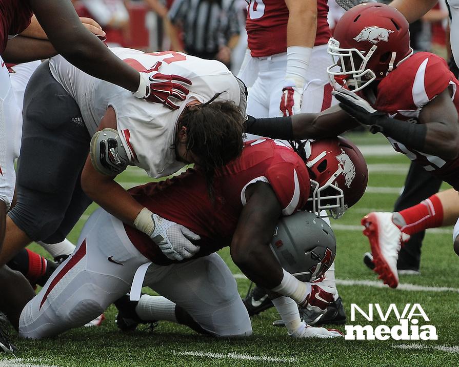 STAFF PHOTO ANTHONY REYES &bull; @NWATONYR<br /> The Razorbacks against Nicholls State in the first quarter Saturday, Sept. 6, 2014 at Razorback Stadium in Fayetteville.