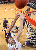 Jan. 2, 2011; Charlottesville, VA, USA; Virginia Cavaliers forward Will Sherrill (22) reaches for the rebound with LSU Tigers forward Garrett Green (3) during the game at the John Paul Jones Arena. Virginia won 64-50. Mandatory Credit: Andrew Shurtleff-
