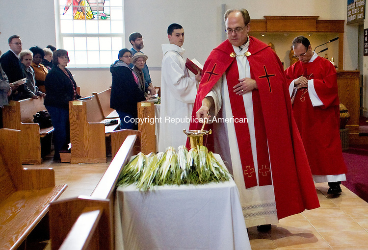 PROSPECT, CT - 04 APRIL 2009 -040409JT11-<br /> Rev. Mark Suslenko blesses palms during Mass at St. Anthony Church on Saturday, April 4, the day before Palm Sunday, in Prospect. <br /> Josalee Thrift Republican-American