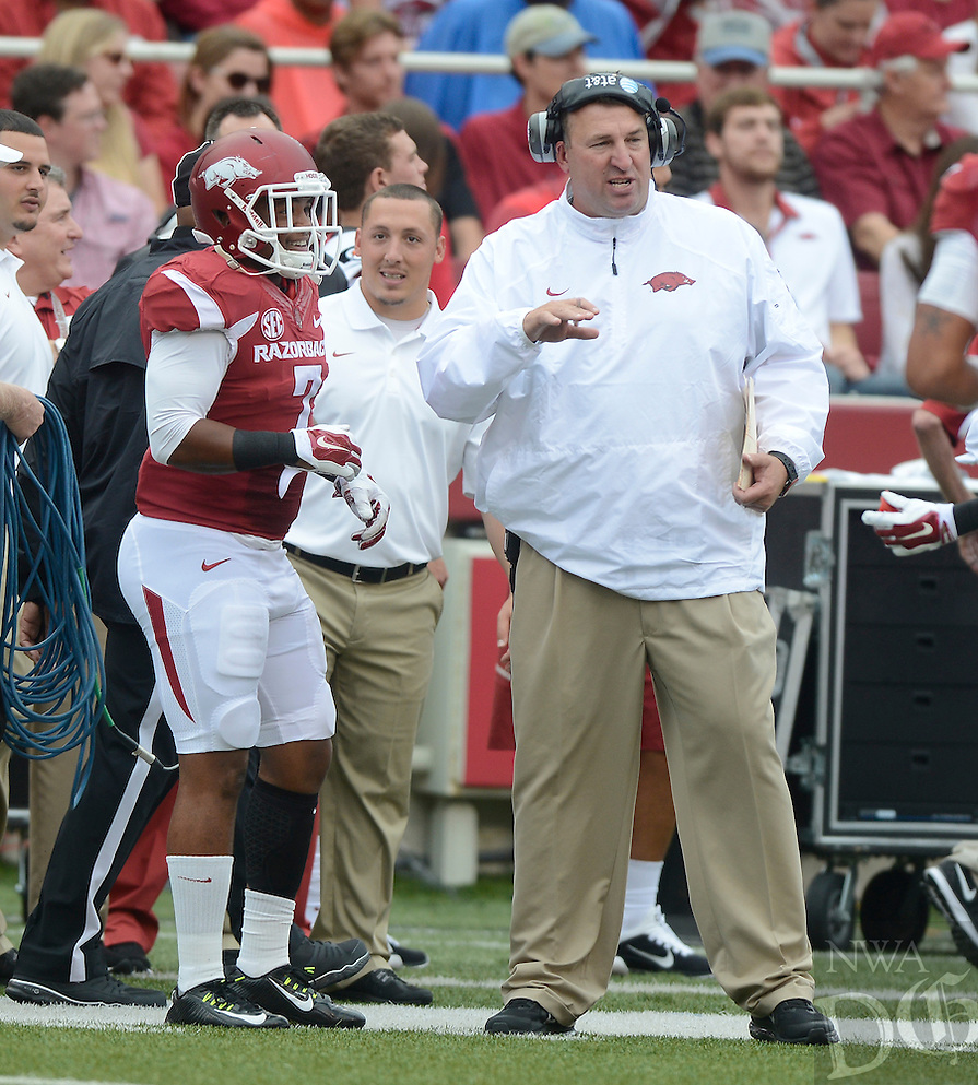 STAFF PHOTO ANTHONY REYES • @NWATONYR<br /> Bret Bielema, Arkansas head coach talks to Tiquention Coleman against Nicholls State in the first quarter Saturday, Sept. 6, 2014 at Razorback Stadium in Fayetteville.