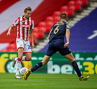 4th July 2020; Bet365 Stadium, Stoke, Staffordshire, England; English Championship Football, Stoke City versus Barnsley; Nick Powell of Stoke City under pressure from Mads Andersen of Barnsley