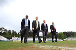 18 April 2015: Match officials walk the field before the game. From left: Assistant Referee Clive Edwards (JAM), Referee Mark Kadlecik, Assistant Referee Benjamin Wooten, and Fourth Official Douglas Hartemann. The Carolina RailHawks hosted the Atlanta Silverbacks at WakeMed Stadium in Cary, North Carolina in a North American Soccer League 2015 Spring Season match. Atlanta won the game 2-1.