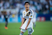 CARSON, CA - SEPTEMBER 29: Uriel Antuna #18 of the Los Angeles Galaxy scores a goal and celebrates during a game between Vancouver Whitecaps and Los Angeles Galaxy at Dignity Health Sports Park on September 29, 2019 in Carson, California.