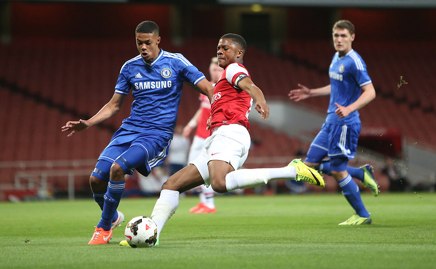 Arsenal's Chuba Akpom despite the attentions of Chelsea's Jake Clarke Salter<br /> <br /> Photo by Kieran Galvin/CameraSport<br /> <br /> Football - The FA Youth Cup Semi Final 2nd  Leg - Arsenal Youth v Chelsea Youth - Thursday 17th April 2014 - Emirates Stadium - London<br /> <br /> &copy; CameraSport - 43 Linden Ave. Countesthorpe. Leicester. England. LE8 5PG - Tel: +44 (0) 116 277 4147 - admin@camerasport.com - www.camerasport.com