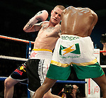 GLASGOW, SCOTLAND - MARCH 10: Ricky Burns of Scotland exchanges blows with Paulus Moses of Namibia during the WBO world lightweight title fight at the Braehead Arena on March 10, 2012 in Glasgow, Scotland. (Photo by Rob Casey/Getty Images)