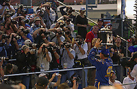 Winner Michael Waltrip holds the Harley J. Earl trophy aloft for the photographers in Victory Lane of the Daytona 500.