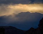 Sunset and storm clouds as seen from the mouth of Titus Canyon, Death Valley National Park, California