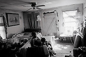 September 11, 2002<br /> Grand Junction, Tennessee<br /> <br /> Tenants of a shanty home watch the 9/11 television specials one year to the day of the tragic events.