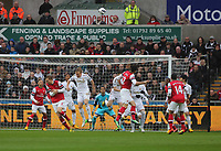 Pictured:  Olivier Giroud of Arsenal (12) heads the ball off target from a team mate's cross. Saturday 16 March 2013<br /> Re: Barclay's Premier League, Swansea City FC v Arsenal at the Liberty Stadium, south Wales.