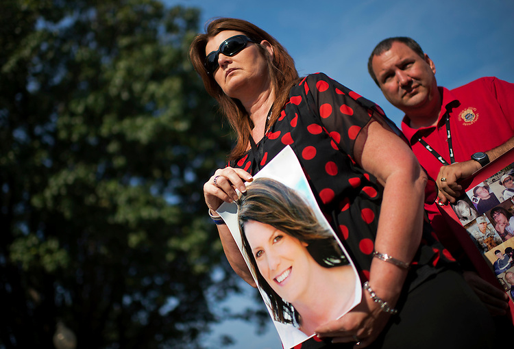 UNITED STATES - SEPTEMBER 27:  Barbara and Alan Weatherford of Gulfport, Miss., hold a picture of their daughter Deanna Tucker, who was killed by a drunk driver in 2011.  Family members of victims gathered for a Mothers Against Drunk Driving (MADD) rally in Upper Senate Park before visiting Hill offices to lobby for driver and highway safety, preventing underage drunken driving and protecting victims' rights.  (Photo By Tom Williams/CQ Roll Call)