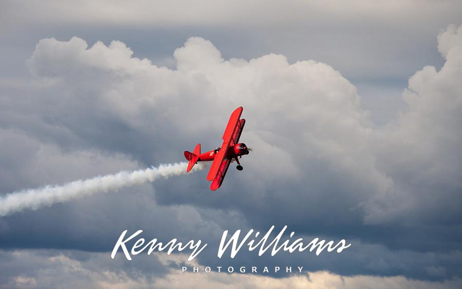 Red vintage biplane, Arlington Fly-In 2016, Washington State, USA.