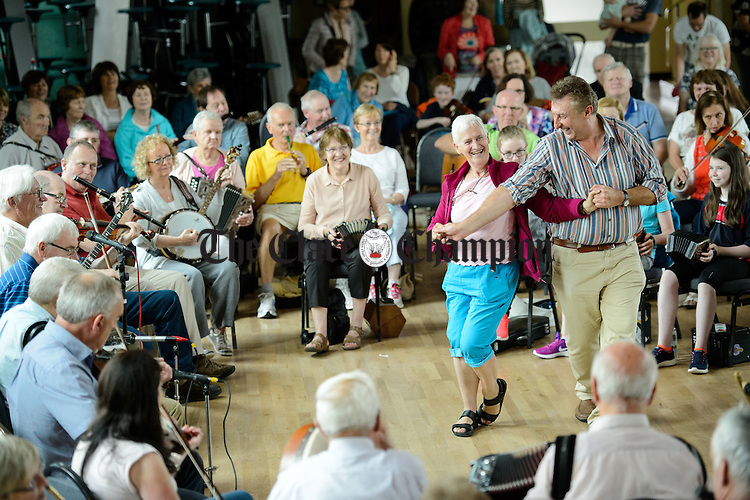 Dancers take to the floor at the Frank Custy session on Thursday at the Holy Family National School during Fleadh Cheoil na hEireann in Ennis. Photograph by John Kelly.