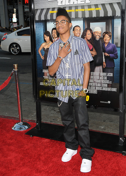 "LIL TWIST aka Christopher L. Moore.World Premiere of ""Lottery Ticket"" held at The Grauman's Chinese Theatre in Hollywood, California, USA..August 12th, 2010      .full length shirt jeans denim hand funny on chest in pocket bun hair up afro blue stripe bow tie glasses .CAP/RKE/DVS.©DVS/RockinExposures/Capital Pictures."