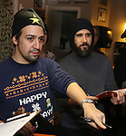 Lin-Manuel Miranda and Josh Groban during the cast of 'Hamilton' 2016 Door Decorating Competition at Richard Rodgers Theatre on December 23, 2016 in New York City.