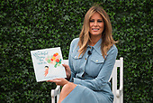 First Lady Melania Trump reads a book to children during the White House Easter Egg Roll at the White House in Washington, D.C. on April 22, 2019.<br /> Credit: Kevin Dietsch / Pool via CNP