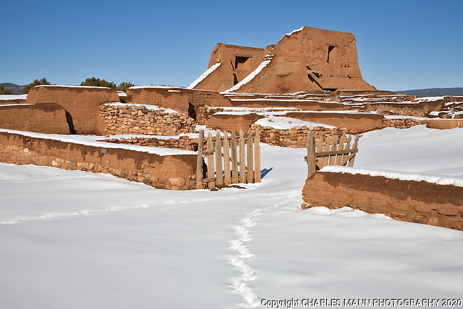 The  ruins at Pecos National Monument near Santa Fe lie blanketed with a fresh carpet of snow on a winter day