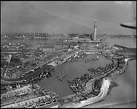 BNPS.co.uk (01202 558833)<br /> Pic: Aerofilms/HistoricEngland/BNPS<br /> <br /> Full off fishing boats - No 1 Fish Dock, Grimsby, 6 May 1925.<br /> <br /> Stunning historic aerial photos of seaside towns, naval bases, ports and shipyards which tell the story of Britain's once-great maritime tradition feature in a new book.<br /> <br /> The fascinating archive of black and white images includes views from a bygone age such as Brighton's famous West Pier, Grimsby's burgeoning fishing fleet, and London's dock yards.<br /> <br /> Iconic ships were also captured from the skies including the Cutty Sark in its final seaworthy years on the Thames, HMY Britannia in 1959, the RMS Queen Mary in 1946 and the SS Queen Elizabeth in 1969 about to make her maiden voyage.<br /> <br /> England's Maritime Heritage from the Air, by Peter Waller, is published by English Heritage and costs &pound;35.