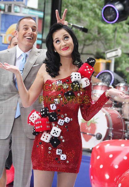 MATT LAUER & KATY PERRY.Seen on the 'Today Show' in Rockefeller Plaza, New York, NY, USA, .July 24th 2009..live on stage concert gig music microphone red and black white fluffy dice sequined half length one shoulder dress funny hands hand gesture shrug shrugging .CAP/LNC/RAF.©LNC/Capital Pictures