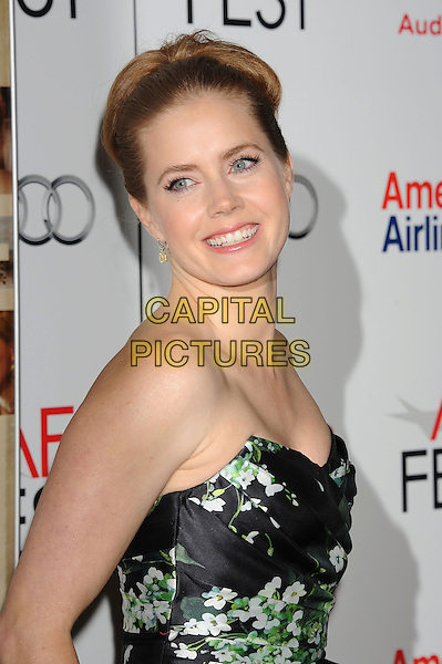 "Amy Adams.The 2012 AFI FEST - ""On The Road"" Gala Screening at Grauman's Chinese Theatre in Hollywood, California, USA..November 3rd, 2012.half length black green floral print smiling strapless dress side.CAP/ROT/TM.©Tony Michaels/Roth Stock/Capital Pictures"