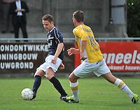 KVC Wingene - KSC Wielsbeke : Bas Vervaeke aan de bal voor de opzittende Angelito Bultynck (rechts)<br /> foto VDB / Bart Vandenbroucke