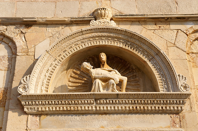 Sculpture of Holy Mary Holding the dead body of Christ by Petar Trogiranin [ 1514 ] above the door of the previous  Cathedral of St Mary the Great (Crkva svete Marije Velike). Rab Island, Craotia