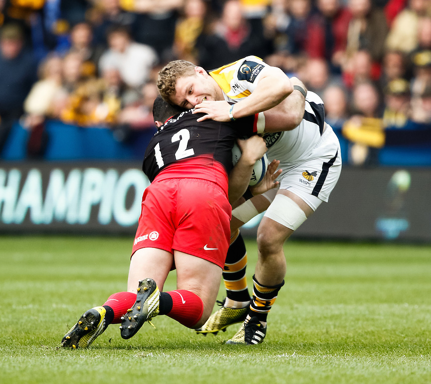 Wasps' Thomas Young is tackled by Saracens' Brad Barritt<br /> <br /> Photographer Simon King/CameraSport<br /> <br /> Rugby Union - European Rugby Champions Cup Semi Final - Saracens v Wasps - Saturday 23rd April 2016 - Madejski Stadium - Reading<br /> <br /> &copy; CameraSport - 43 Linden Ave. Countesthorpe. Leicester. England. LE8 5PG - Tel: +44 (0) 116 277 4147 - admin@camerasport.com - www.camerasport.com