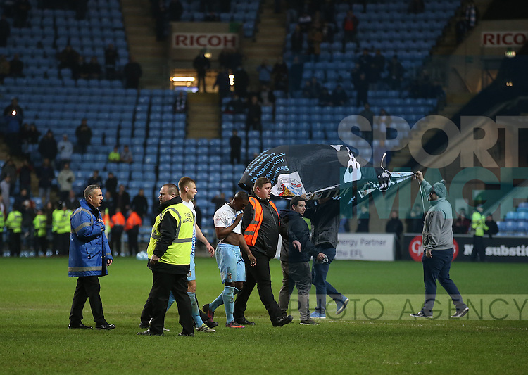 Coventry fans invade the pitch during the English League One match at the Rioch Arena Stadium, Coventry. Picture date: December 15th, 2016. Pic Simon Bellis/Sportimage