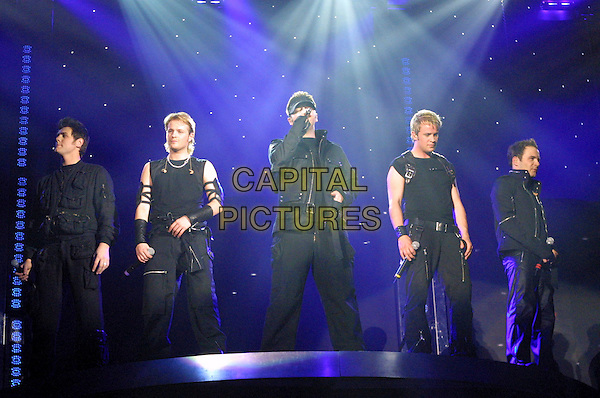 WESTLIFE<br /> Live in concert at London Arena<br /> April 17th, 2003<br /> stage concert live gig performance music black singing boyband Brian mcfadden bryan, kian egan, mark feehliy, nicky byrne shane filan full length<br /> www.capitalpictures.com<br /> sales@capitalpictures.com<br /> &copy; Capital Pictures