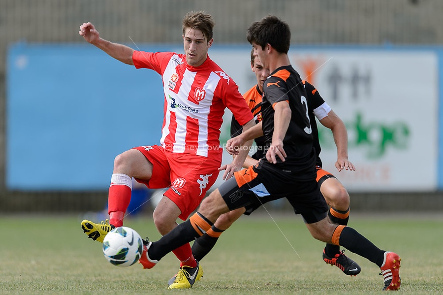 MELBOURNE - 3 NOV: Stipo ANDRIJASEVIC of the Heart and Cameron CRESTANI of the Roar compete for the ball in the round three National Youth League match between Melbourne Heart and Brisbane Roar at John Cain Reserve on 3 November 2012. (Photo Sydney Low/syd-low.com/Melbourne Heart)