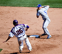 Koby Kraemer (5) of the Indiana State Sycamores turns a double play during a game against the Evansville Purple Aces in the 2012 Missouri Valley Conference Championship Tournament at Hammons Field on May 23, 2012 in Springfield, Missouri. (David Welker/Four Seam Images).