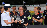 Christie Rampone presented with trophy by U.S Coast Guard Lt Tracy Wirth..WPS All-Star Team defeated Umea IK (Sweden) 4-2, at Anhueser Busch Soccer Park, Fenton, MO.