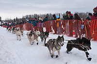 Rob Loveman team leaves the start line during the restart day of Iditarod 2009 in Willow, Alaska