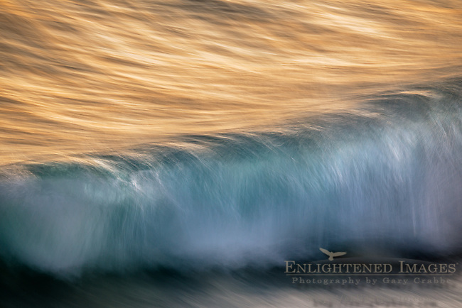 Waves breaking at sunset along the Kailua-Kona shoreline, on the Big Island of Hawai'i, Hawaii