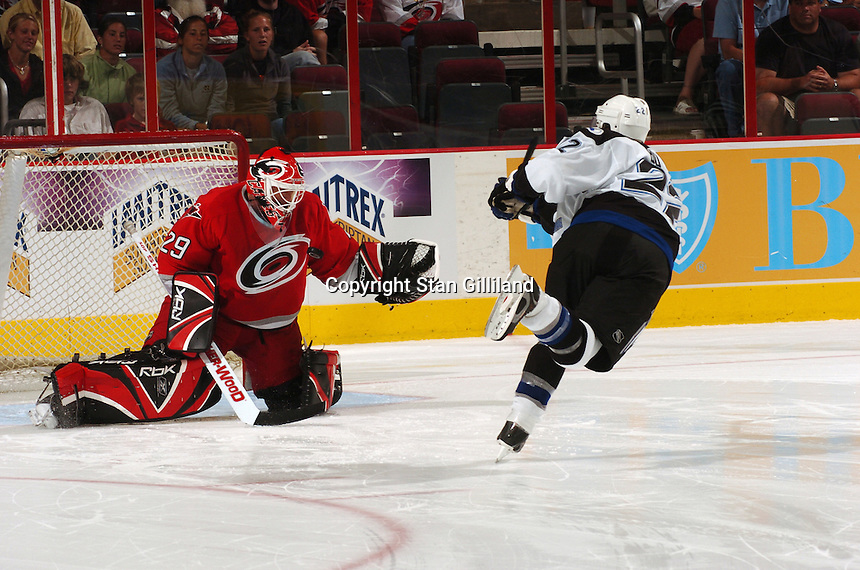 Carolina Hurricanes' goaltender Martin Gerber makes a save against the Tampa Bay Lightning's Dan Boyle (22) during their game Thursday, Sep. 22, 2005 in Raleigh, NC. Carolina won 5-2.