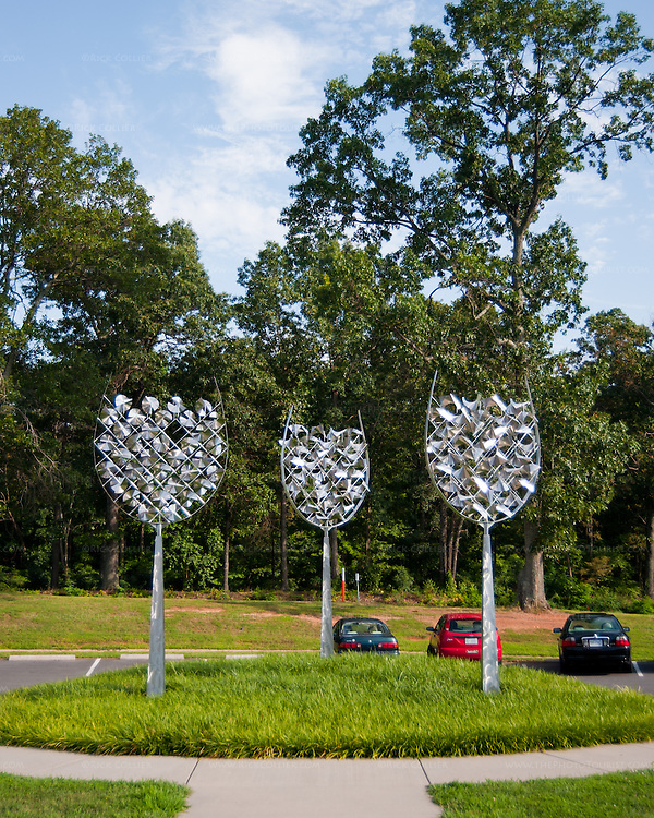A modern sculpture of three wine glasses stands in the parking area in front of the event and tasting building at Prince Michel Vineyard and Winery.